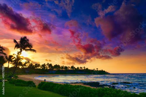 Spectacular sunset over a Pacific Ocean beach on Kauai, Hawaii, USA Photo by Don Landwehrle