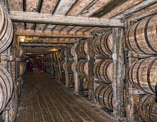 Barrels maturing Bourbon in Distillery in Bardstown Kentucky USA плакат