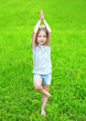 canvas print picture - Little girl child on the grass does yoga exercise outdoors in su