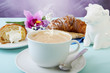 Leinwandbild Motiv cappuccino and croissants