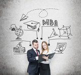 Young prosperous couple are thinking about MBA degree and checking some information in the black folder. Educational chart is drawn behind them. poster