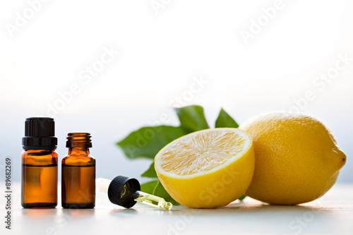 Lemon essential oils in bottles with lemon Poster