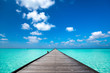 Wooden pier with blue sea and sky background - 89728690
