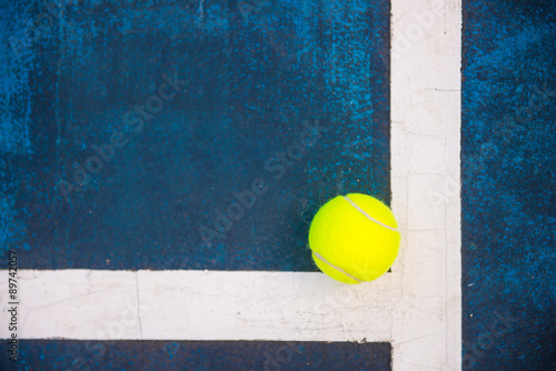 Juliste tennis ball on a tennis court