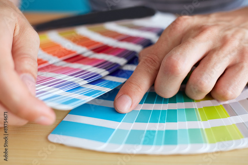 Poster Graphic designer choosing a color