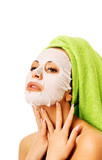 Woman with revitality face mask poster