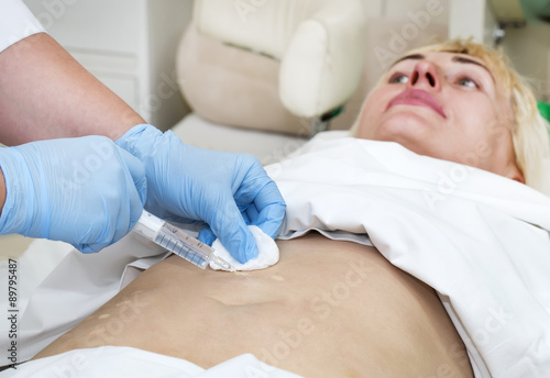 poster of woman is in the process cellulite mesotherapy clinic