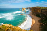 Fototapety The landmark Twelve Apostles along the famous Great Ocean Road, Victoria, Australia with beach at base of cliffs in foreground