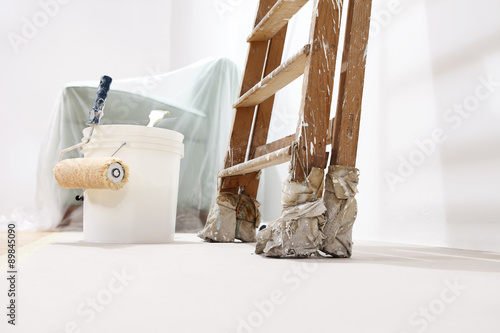 painter wall concept, ladder, bucket, roll paint on the floor Poster