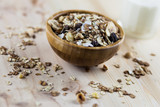 Muesli, granola and milk in blurred wooden background. (Shallow aperture intended for  the aesthetic quality of the blur.) poster
