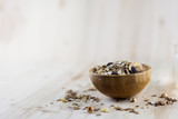 Muesli and granola in blurred wooden background. (Shallow aperture intended for  the aesthetic quality of the blur.) poster