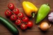 fresh farm vegetables on wooden desk