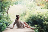 beautiful girl on old wooden brdge in forest