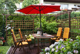 Fototapety Wooden furniture with umbrella in backyard patio.