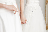 Two people of the bride holding hands