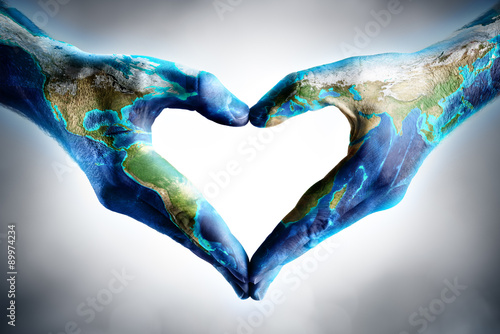 Zdjęcia na płótnie, fototapety, obrazy : earth's day celebration - hands shaped heart with world map