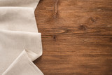 Fototapety Tablecloth textile on wooden background