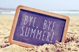 Fototapety text bye, bye summer in a chalkboard on the beach
