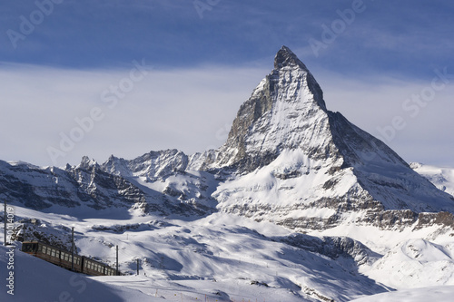 Poster Winter view of the Matterhorn with train on the foreground