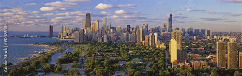 Tuinposter Chicago This is Lincoln Park with Diversey Harbor in the foreground and Lake Michigan on the left looking south. It shows the skyline in morning light in the summer. The John Hancock Building is fairly prominent toward the left hand side.