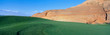 This is the Page Municipal Golf Course with a background hill made of sandstone rock. It shows a green golf course in the middle of a desert environment.
