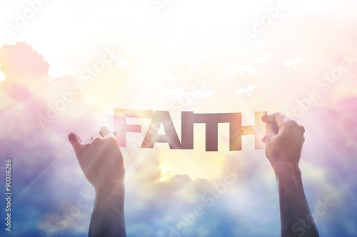 Poster abstract, hand holding a word faith icolorful sky in the natue