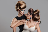 Fototapety Studio photo of two beauty women with creative hairstyle looking