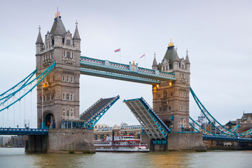LONDON, UK - APRIL 15, 2015: City of London panorama at sunset. Tower bridge and River Thames