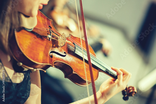 Symphony orchestra on stage, hands playing violin - 90080029