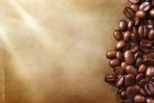 Coffee beans on grunge paper background