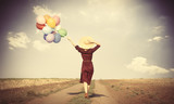 girl with multicolored balloons and bag - 90175247