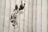 Banksy falling shopper graffiti, London