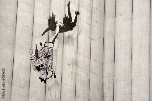 Fotografiet Banksy falling shopper graffiti, London