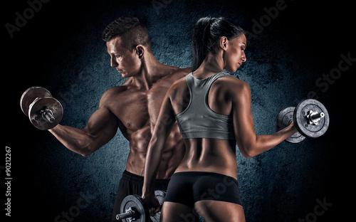 Sticker Athletic man and woman with a dumbells.