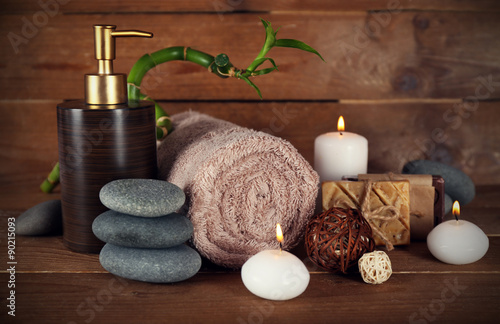 Beautiful spa composition with candles on wooden background © Africa Studio