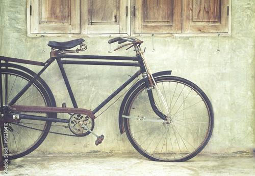 Foto op Plexiglas Fiets Vintage bicycle in coffee house, film look instagram effect