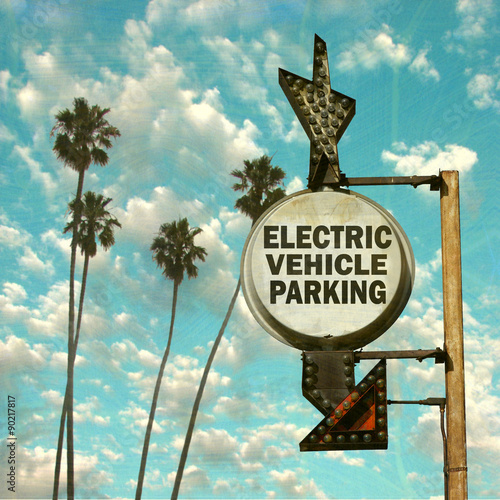 aged and worn vintage photo of electric vehicle parking sign Poster