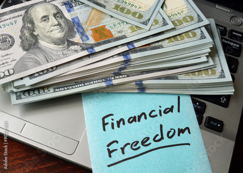 Financial Freedom  written on notebook with charts. Photo by designer491