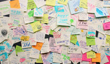 Fototapety Post-it notes sticked chaotically on the wall - busy concept