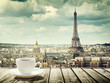 Leinwanddruck Bild - background with cup of coffee and Eiffel tower in Paris