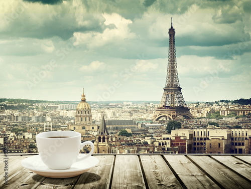 Leinwanddruck Bild background with cup of coffee and Eiffel tower in Paris