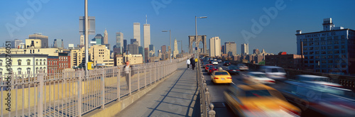 Panoramic view of speeding taxis driving over Brooklyn Bridge to Manhattan, New York City, NY