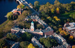 AERIAL VIEW of Harvard Campus featuring Eliot House Clock Tower along Charles River, Cambridge, Boston, MA.