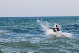Man on jet ski with high speed and adrenalin. poster