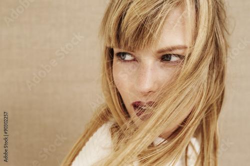 Beautiful blond woman looking away © sanneberg