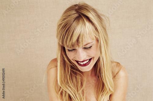 Giggling blond woman in studio © sanneberg