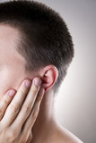 Man with a earache. Pain in the human body