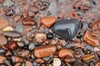 Lake Superior Shoreline with close up of colorful wet shiny rocks.