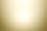 Abstract gold flare gradient paper skin background.