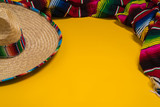Fototapety Mexican Sobrero and Serape blanket on yellow background with cop